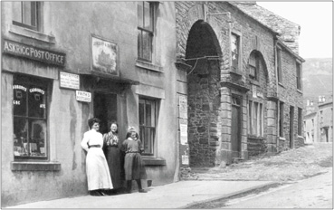 """Frith's Postcards for sale here!"" Women outside the Post Office, Askrigg 1911, 63469x."