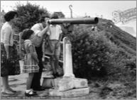 Cromer, Family at the Telescope c1955, C192038x.